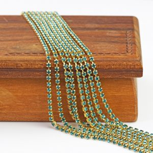 2.1 mm rhinestone chain with Indicolite Preciosa crystals in raw setting x 20 cm