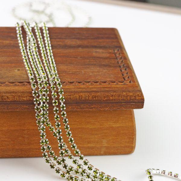 2.1 mm rhinestone chain with Olivine Preciosa crystals in silver setting x 20 cm