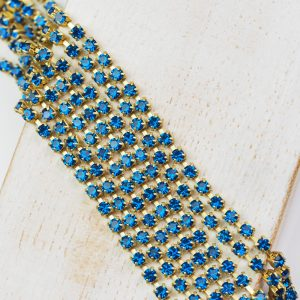 2.4 mm rhinestone chain with Capri Blue Preciosa crystals in raw setting x 20 cm