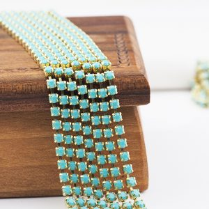 2.4 mm rhinestone chain with Turquoise Preciosa crystals in raw setting x 20 cm