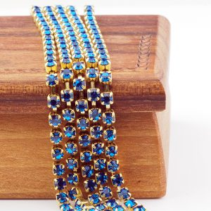 3.2 mm rhinestone chain with Capri Blue Preciosa crystals in raw setting x 20 cm