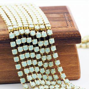 3.2 mm rhinestone chain with Chrysolite Opal Preciosa crystals in raw setting x 20 cm