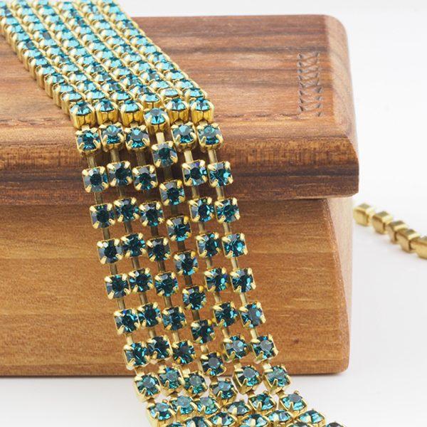 3.2 mm rhinestone chain with Indicolite Preciosa crystals in raw setting x 20 cm