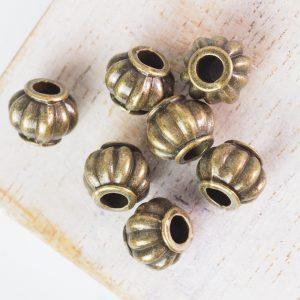 9.5x7.5 mm metal bead bronze x 10 pc(s)